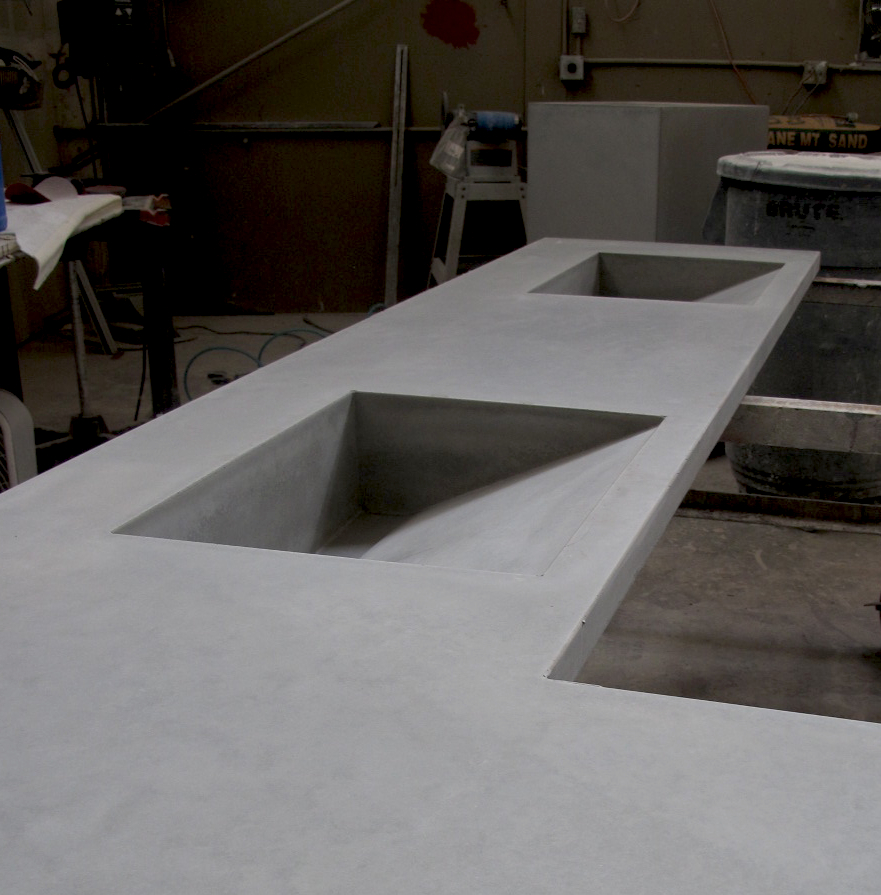 The custom cement sinks and countertop for the master bath at Desert Rain in the process of final finishing.
