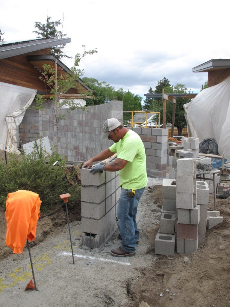 Rick Siers with Kevin Spencer Masonry building the 'Miro' wall.