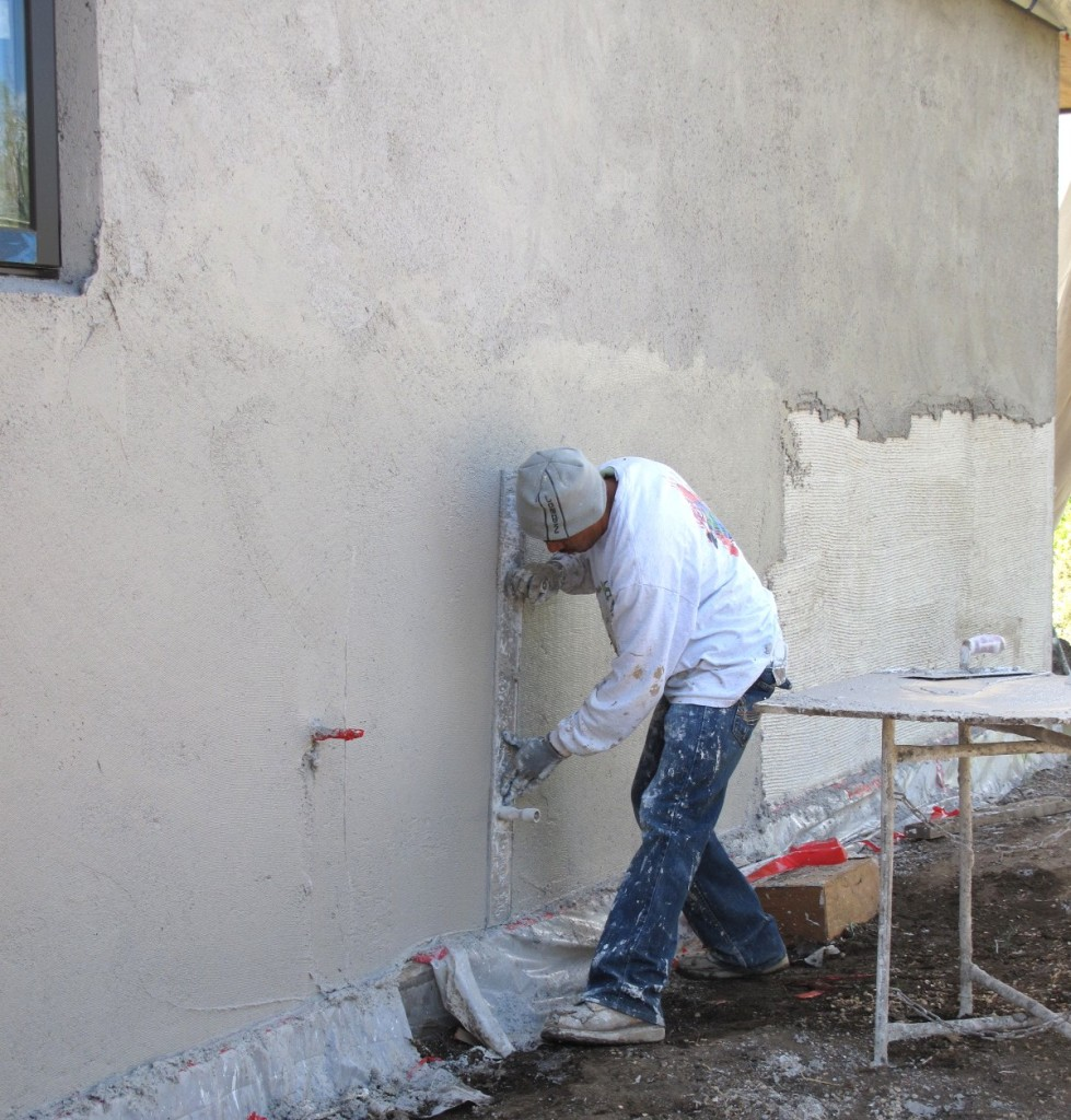 Juan working on the second coat of the main house.
