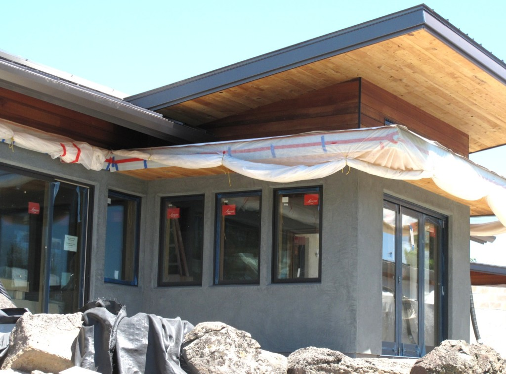 Soffits use reclaimed wood. The upper cedar siding is FSC. The Loewen window frames are FSC.