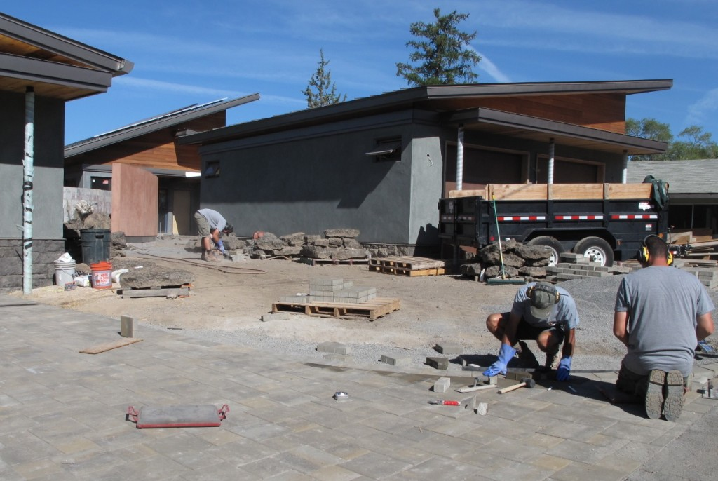 Hardscaping is underway outside with installation of pavers and driveway.