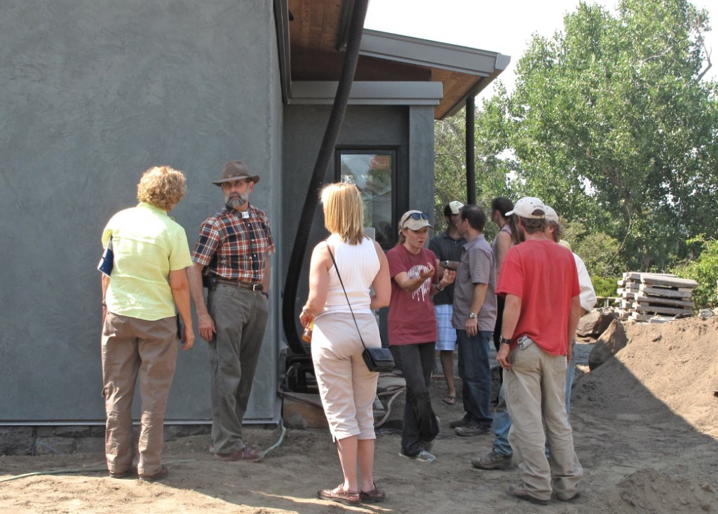 Tom explains some of the exterior elements of Desert Rain to part of the tour. Visitors included designers, builders, contractors, and homeowners from the local area and as far away as Germany.
