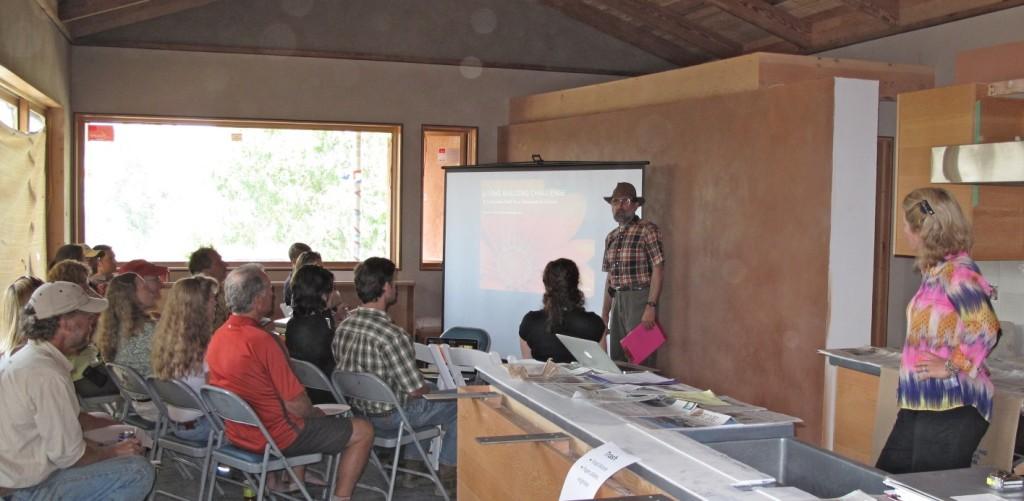 Tom begins the presentation telling the story of the dream for Desert Rain.