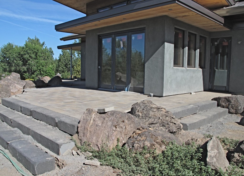 The south patio with basalt steps, boulders, and pavers in place.