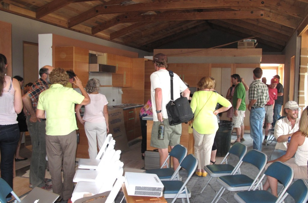 Visitors tour the home and explore the elements and materials.