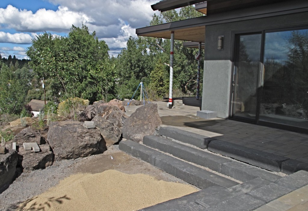 The south patio with pavers, rocks, and basalt steps.