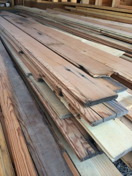 Salvaged wood waiting to be installed as soffits.